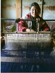 "A young woman carries on her family's tradition of ""yata"" or wool weaving Buonthang, Bhutan."