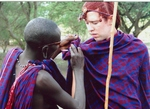 Maasai Dress: A Maasai pastoralist helps and admirer with his own shuka