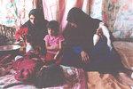 Shamsa putting henna on her daughter's feet