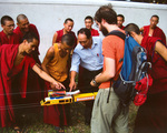 Monks show an SIT student their home-made rocket