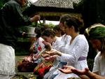 "SIT students attending a temple ceremony in Bali while wearing ""pakian adat"", traditional Balinese temple dresses."