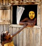 A woman and young girl pose for a photo in a village nestled in the Spiny Forest near Ifotaka, Madagascar.